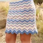 Разноцветная юбка зигзаг спицами от Drops